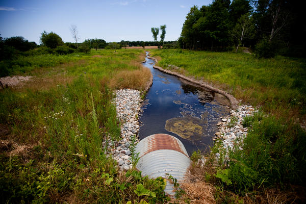 A culvert carries Talmadge Creek under a road in Marshall, Mich. After the spill, this small creek was flooded with oil, carrying it to the Kalamazoo River in the distance. Enbridge cleaned this area of oil twice. The second cleaning occurred after Bolenbaugh appeared on a local news channel falling through winter ice into a pool of oil in an area the company had declared free of oil.
