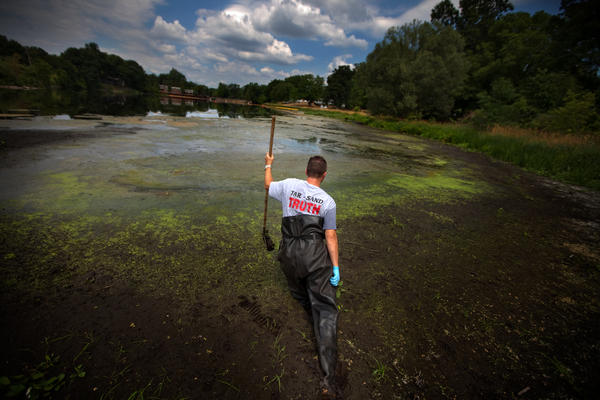 Whistle-blower John Bolenbaugh wades through thick mud in the Kalamazoo River looking for leftover traces of oil from the July 2010 Enbridge tar sands pipeline spill.