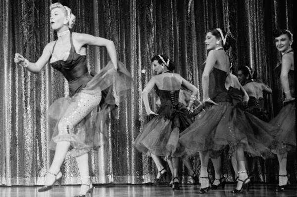 "Day plays chorus girl Ethel ""Dynamite"" Jackson in 1952's <em>April in Paris</em>."