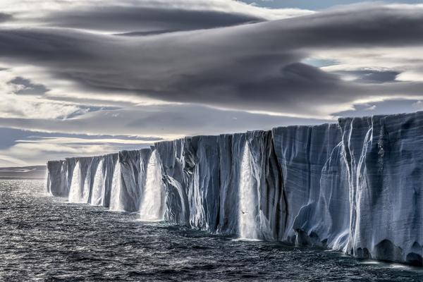The Nordaustlandet ice cap gushes high volumes of meltwater. Even though this photograph was taken just 600 miles from the North Pole, the temperature was in the high 60s Fahrenheit.