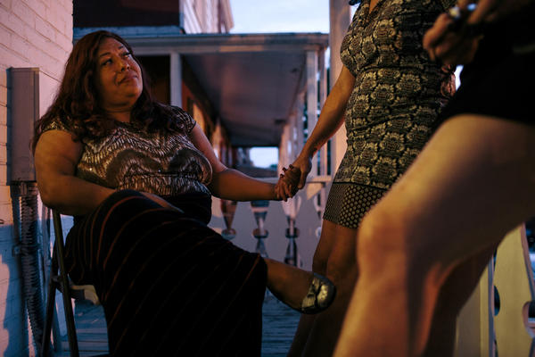 Ruby Corado (left) with her friend and Casa Ruby board member Consuella Lopez on the porch of one of the transitional group homes Corado runs in Washington, D.C., in 2015.