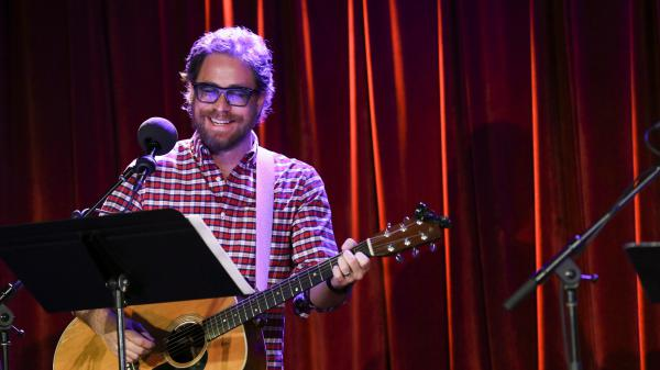 House musician Jonathan Coulton leads a parody game on <em>Ask Me Another</em> at the Bell House in Brooklyn, New York.