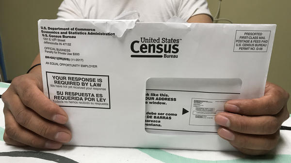 A Rhode Island resident holds an envelope he received for the 2020 census test run in Providence County.