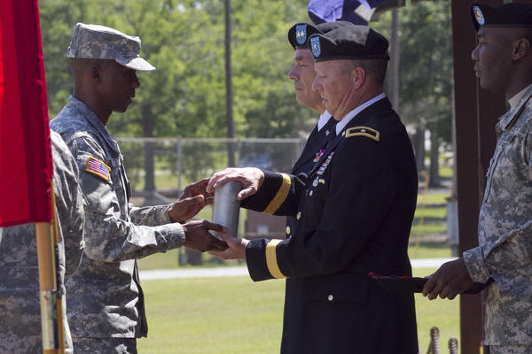 Gen. William J. Gothard (right) receives a spent shell casing as part of his 2014 retirement ceremony at Fort Jackson, S.C.  Gothard says his 36 years of service left him with hearing loss and tinnitus.