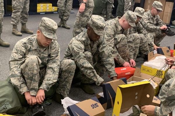 New Air Force recruits try on shoes from San Antonio Shoemakers, Propper Footwear, and New Balance. Since January, the Defense Department has been issuing the shoes free of charge.
