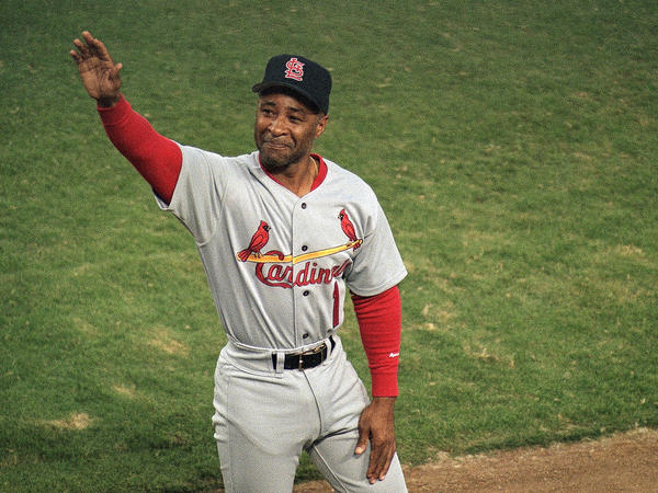 St. Louis Cardinals shortstop Ozzie Smith waves to fans on Sept. 13, 1996.