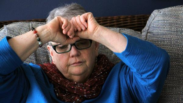 Patricia Cahill pauses to collect herself as she recounts her story of child sexual abuse in the Roman Catholic Church.