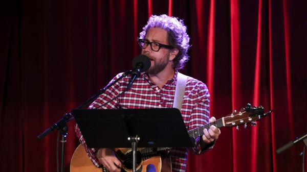 <em>Ask Me Another</em> house musician Jonathan Coulton leads a music parody game at the Bell House in Brooklyn, New York.