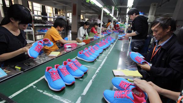 Workers makes shoes at a factory in Jinjiang, in southeast China's Fujian province. Nearly all shoes sold in the U.S. are foreign-made. China's share has declined, but it's still a major source.