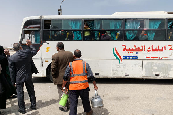 Palestinians wave goodbye to people aboard a bus before it leaves to cross into Egypt. As conditions at home worsen, thousands of Gazans have crossed the Egyptian border since May 2018, seeking a better life.
