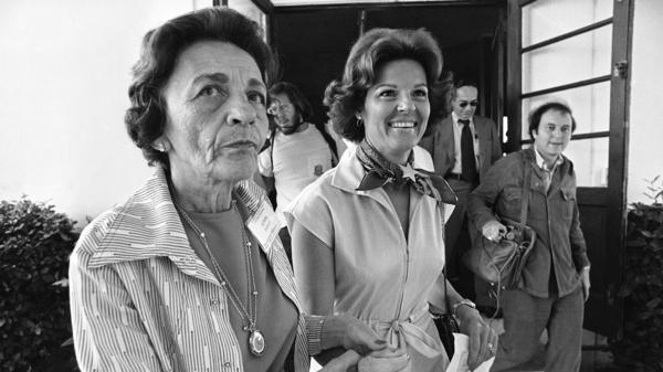 Singer Anita Bryant (right) is led to the voting booth at her Miami Beach polling place by volunteer Leah Dezen in 1977. Bryant was the leader of the opposition group Save Our Children, whose members pushed for the repeal of a gay-rights ordinance in Miami-Dade County.