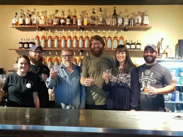 Dueling Grounds Distillery employees, left to right, are Elizabeth Wimpee, Josh Henderson, owner Marc Dottore, Steve Whitledge, Jennifer Houck and Santos Garcia.