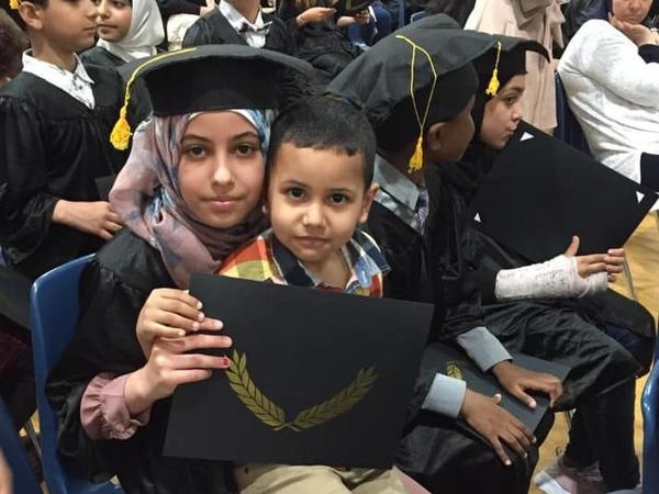 Sara Mohsin, 12, and Muslim Mohsin, 3, at her fifth grade graduation.<strong> </strong>