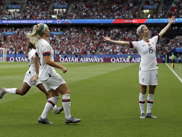 American player Megan Rapinoe, right, celebrates after scoring her team's first goal during the Women's World Cup quarterfinal soccer match between France and the United States Friday.