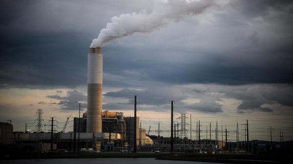 Emissions rise from the Duke Energy coal-fired Asheville Power Plant ahead of Hurricane Florence in Arden, N.C., in September 2018. Regulators are supposed to make sure Duke Energy delivers reliable power at the lowest possible cost — and that's always been interpreted as cost to the consumer, not cost to the environment.