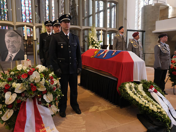 An honor guard stands at the coffin of assassinated German politician Walter Lübcke at his memorial service on June 13 in Kassel, Germany. Lübcke, a Christian Democrat, was outspoken in his pro-immigration views. His confessed killer is an avowed neo-Nazi with a 20-plus-year history of violence against immigrants.