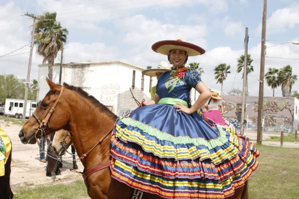 A Charra prepares to ride in the Grand International Parade on Saturday.
