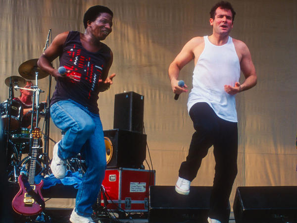 South African musician Johnny Clegg, right, with his longtime bandmate Sipho Mchunu, performing in New York City in 1996. Clegg died Tuesday at age 66.
