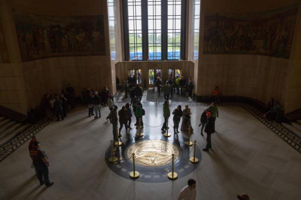 <p>People mingle in the rotunda of the Oregon Capitol following a rally against proposed cap-and-trade legislation, House Bill 2020, in Salem, Ore., on Thursday, June 27, 2019.</p>