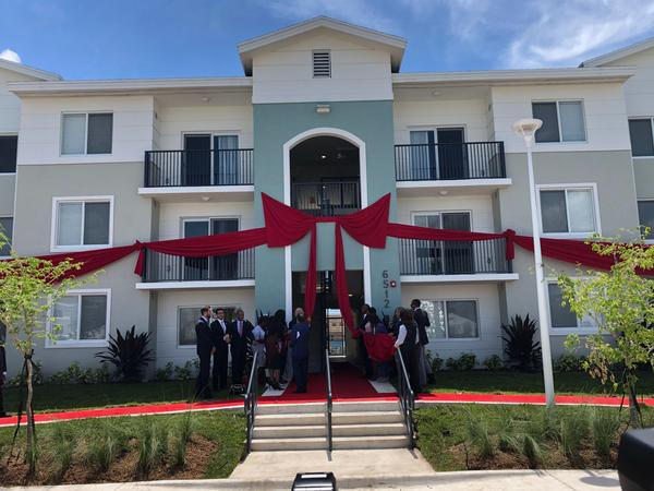 Miami-Dade County Mayor Carlos Giménez, Chairwoman Audrey Edmunson, U.S. Housing and Urban Development Secretary Ben Carson and others participate in the ribbon-unveiling ceremony of phase one of Liberty Square redevelopment.