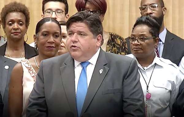 Gov. J.B. Pritzker addresses a crowd during a press event on Illinois' newly-signed state infrastructure plan in Chicago