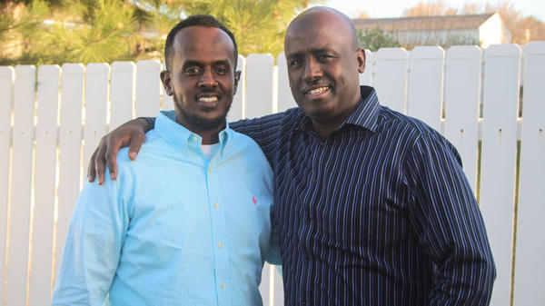 Jamal Batar and his father, Aden, at StoryCorps in West Valley City, Utah, in March 2017. The Batar family fled the civil war in Somalia for the United States in 1994.