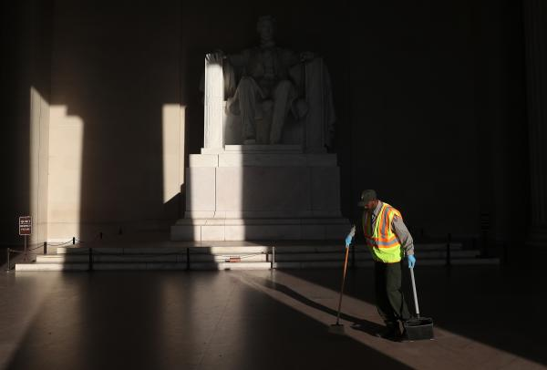 National Park Service worker Corey Felder picks up trash inside the Lincoln Memorial on Tuesday ahead of Thursday's July 4 celebration.