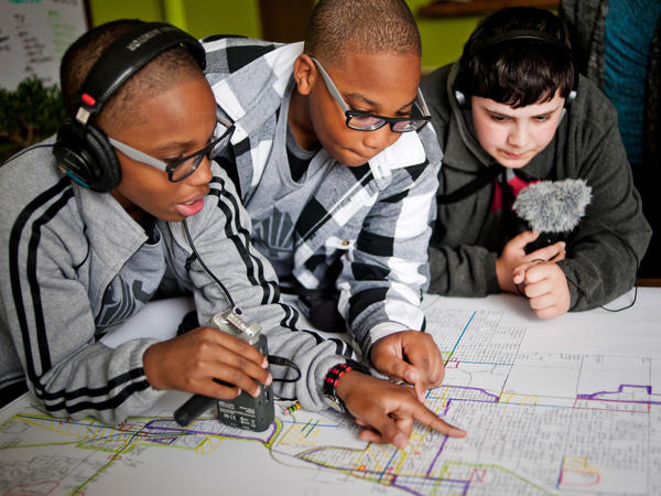 From left, students Erin Addison, Evan Addison and Andrew Arevalo of the Steel City Academy look over a planning map of Gary, Ind.