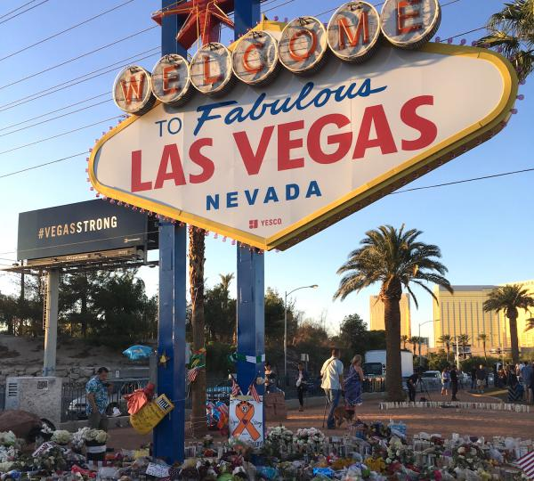 The Las Vegas Strip sign on Oct. 9, 2017, became an informal memorial after the shooting at a music festival the week prior that left 59 dead.