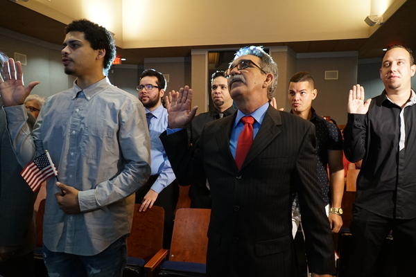 New citizens José Viñas and Roberto Milían make the oath of allegiance side by side the morning of July 3 at the Ernest F. Coe Visitor Center at the Everglades National Park.