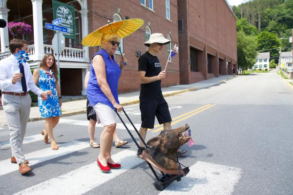 Retiring Vermont Supreme Court Justice Marilyn Skoglund parades her mounted boar's head, Emmett, to his new home with her former law clerk and Montpelier attorney, Michael Donofrio, on Wednesday.
