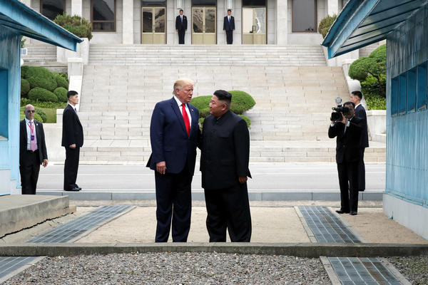 North Korean leader Kim Jong Un and U.S. President Donald Trump stand inside the demilitarized zone  separating South and North Korea on June 30, 2019. The two briefly met at the DMZ on Sunday, with an intention to revitalize stalled nuclear talks and demonstrate the friendship between both countries.