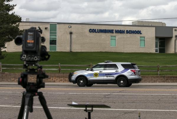 Police patrol outside Columbine High School in April in Littleton, Colo., when all Denver-area schools were evacuated after authorities launched a manhunt for Sol Pais, a Columbine-obsessed teen who they feared posed a threat.
