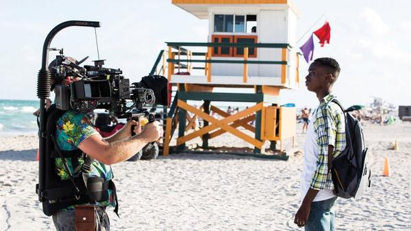 """Cinematographer James Laxton and actor Ashton Sanders filming on location for 2016's """"Moonlight."""" The movie, which won the Oscar for Best Picture, was set and shot in Miami."""