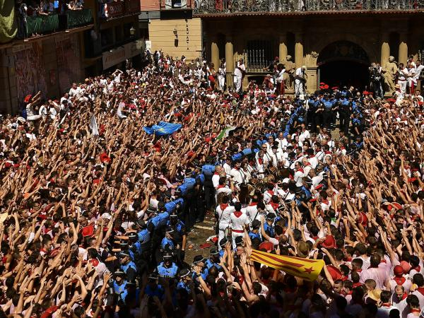 Revelers celebrate the official opening of the 2019 San Fermin fiestas in Pamplona, Spain, Saturday.