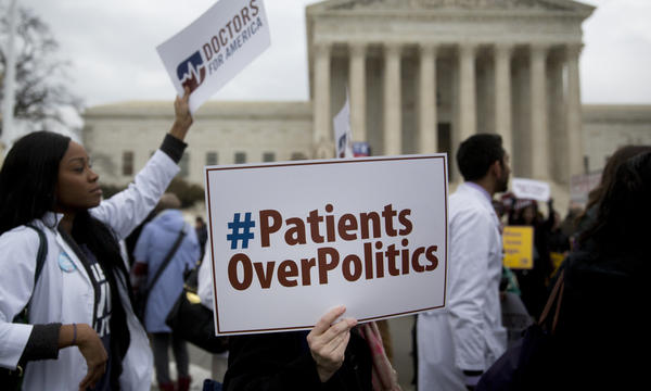 Demonstrators from Doctors for America marched in support of the Affordable Care Act outside the U.S. Supreme Court in March 2015. Now, another case aims to undo the federal health law: <em>Texas v. United States</em> could land in front of the Supreme Court ahead of the 2020 election.