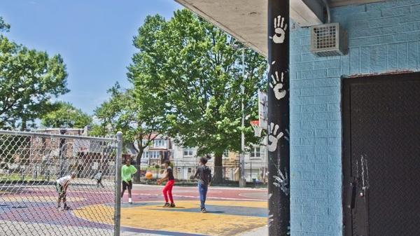 A sonic device is seen (at top right) at Barrett Playground in Philadelphia. Thirty parks in the city have the devices, which emit a constant, high-pitched noise that only teenagers and young adults can hear.