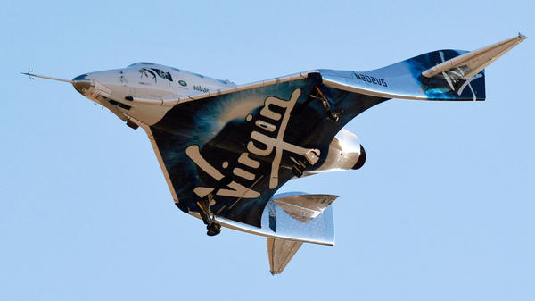 Virgin Galactic's space tourism rocket plane SpaceShipTwo returns after a test flight in California on Dec. 13, 2018. Billionaire Richard Branson is partnering with a group of investors to take his space tourism company public.