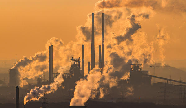 Steam and exhaust rise from a chemical company and a coking plant in Oberhausen, Germany. (Lukas Schulze/Getty Images)