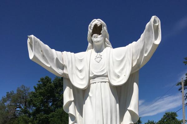 The vandalized Jesus statue at Serenity Memorial Park on Peoria's South Side.