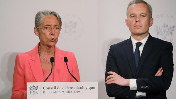 "French Transport Minister Elisabeth Borne says a new tax on airfares ""is a response to the ecological urgency and sense of injustice expressed by the French."" She's seen here with Minister for the Ecological and Inclusive Transition Francois de Rugy."