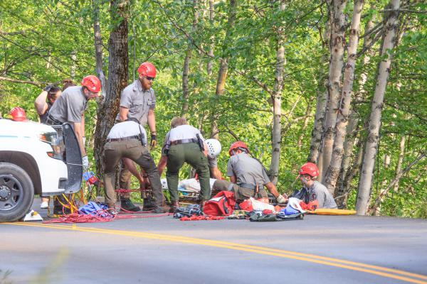 Glacier Park rangers rescue a person inolved in a crash on Going-to-the-Sun Road, July 8, 2019.