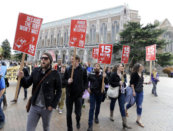 Students and other supporters protest in 2015 on the University of Washington campus in Seattle, in support of raising the minimum wage for campus workers to $15 an hour.