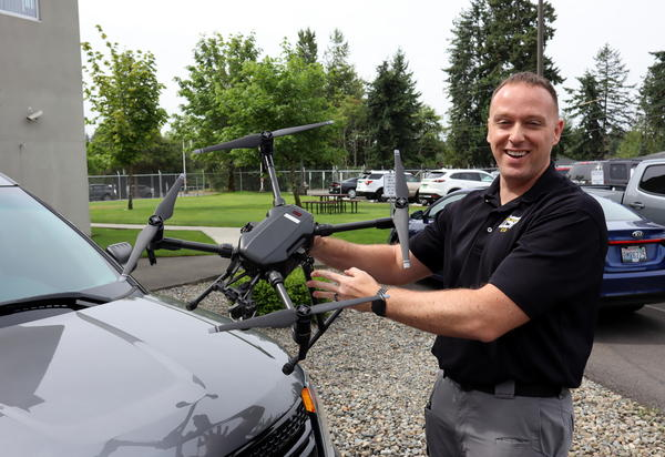 Tacoma-based Detective Sergeant Clint Thomas holds one of the Washington State Patrol's 111 drones, a DJI Matrice 200 model.