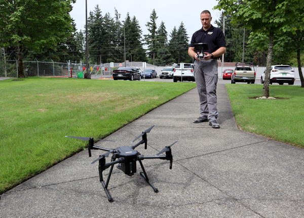 WSP Detective Sergeant Clint Thomas prepares a DJI Matrice 200 for take off
