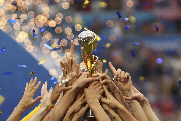 The United States players hold the trophy celebrating at the end of the Women's World Cup final soccer match between US and The Netherlands at the Stade de Lyon in Decines, outside Lyon, France, Sunday, July 7, 2019. The US defeated the Netherlands 2-0.