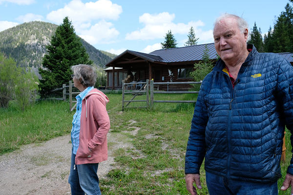 Duncan Patten and his wife stand in front of their home at Black Butte Ranch, July 10, 2019.