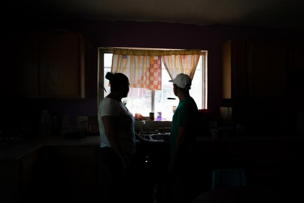 Tania and her husband, Joseph, stand in the kitchen of the space they are sharing with other migrants at a shelter in Juárez, Mexico. She and her husband are from Honduras and are seeking asylum in the U.S. Tania witnessed her mother's slaying back home.