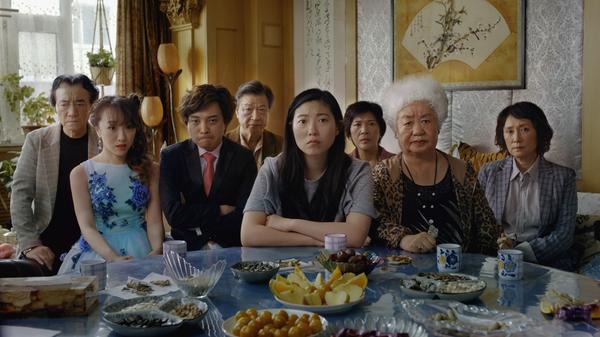 When her grandmother is diagnosed with a terminal illness, Billi (played by Awkwafina, center) reluctantly agrees to go along with her family's plan to pay respects to their matriarch — without letting her know she is dying.