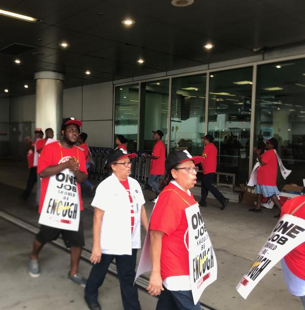 LSG Sky Chefs workers picketed for higher wages and safer working conditions on Wednesday at Miami International Airport.